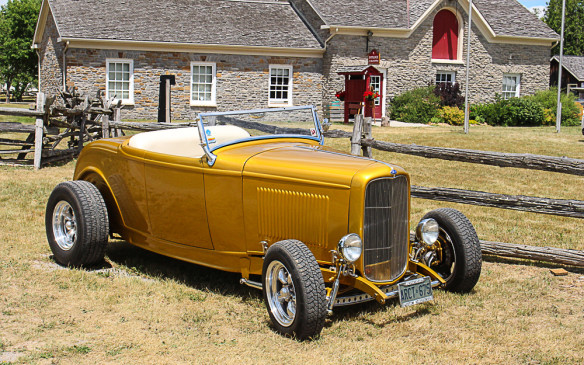 <p><strong></strong>The hot rod set was represented by this traditional 1932 Ford Lowboy, shown here against the background of the Pioneer village entrance.</p>