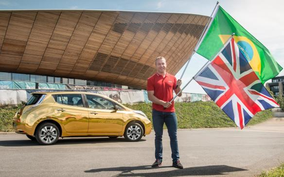 <p>Nissan gold Leaf with Sir Chris Hoy</p>