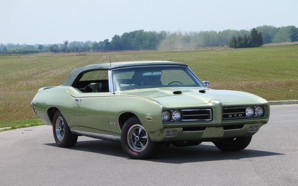 """<p>From the same era but the other end of the sporty-car spectrum will be this 1969 Pontiac GTO Judge Ram Air-III Convertible. Purchased new in Canada it is one of just 108 true Judge convertibles built, one of just 29 with an automatic transmission, and one-of-one built in """"triple-green.""""</p>"""