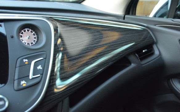 <p>To my eyes, the faux wood didn't add value to the interior; rather it brought it down a peg in the luxury department. If Buick is serious about its Envision competing with the Audi Q5s of the world, it needs to up its game with some real wood trim.</p>