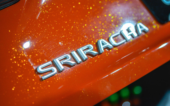 "<p>""Lexus experimented with a range of mixtures and methods—including adding Sriracha sauce to the paint itself—to create the Sriracha Red colour, complete with flecks of chili-like flakes. The custom paint job was designed to mimic Sriracha sauce inside the bottle and topped with a clear coating.""</p>"