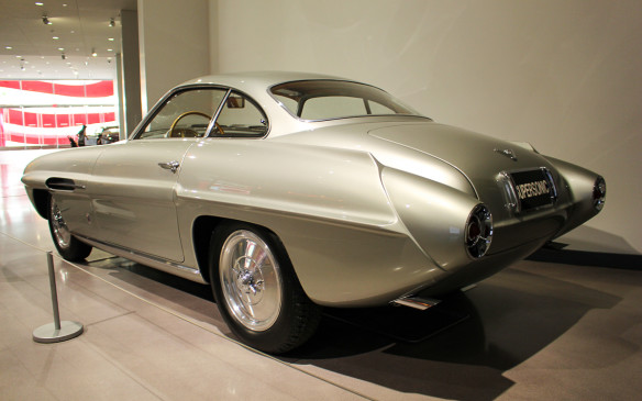 <p>This silver-coloured Fiat special is one of a small series of cars built by Ghia and labeled Supersonic because of their styling similarity to jet aircraft of the day. It's located in the lobby to promote another special exhibit called 'Precious Metal II', in which all the cars, mostly rare and exotic, are finished in the same metallic colour.</p>