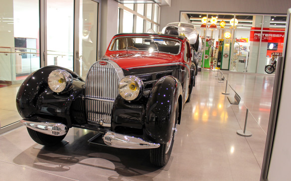 <p>There's something to satisfy every automotive taste at the Petersen – from Bugattis to hot rods, star cars to dream cars, and everything in between. That incredible diversity is apparent before one even gets past the lobby, where this Classic Bugatti Type 57 is just one of multiple cars on display there.</p>