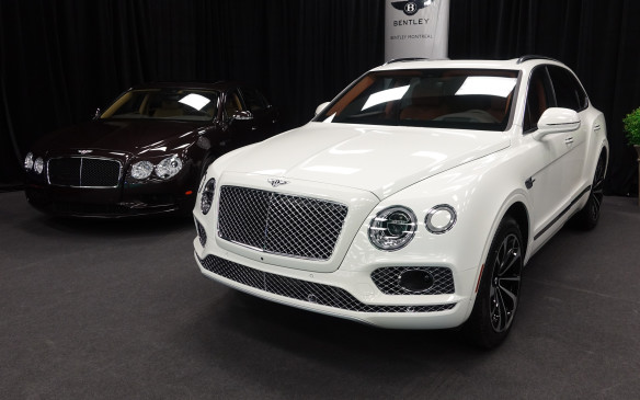 <p>The imposing Bentley Bentayga, the noble British marque's first-ever sport-utility vehicle, almost dwarfs the otherwise stately Flying Spur ultra-luxury sedan that poses alongside.</p>