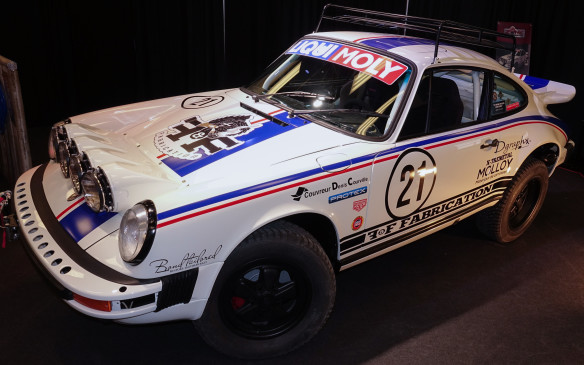 <p>F&F Fabrication, a tuning and restoration shop that obviously loves to work on Zuffenhausen's best, showed this neat, fully-functional, off-road-ready version of the classic Porsche 911. The red, white and blue coupé immediately evokes the cars that won the legendary Paris-Dakar 'rally-raid' twice and four editions of the equally famous Monte Carlo rally.</p>