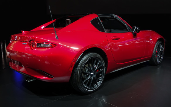 <p>The aluminium roof panel that turns the Mazda MX-5 RF into a virtual coupé is stowed behind the cabin in a few seconds, taking away not the slightest bit of cargo volume from the small trunk, another technical <em>tour de force</em> by Mazda's clever engineers.</p>