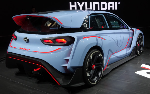 <p>In rear view, the Hyundai RN30 concept shows off its large, cap-style wing atop the hatch, a huge extractor underneath and heavily-flared wheel arches front and rear.</p>