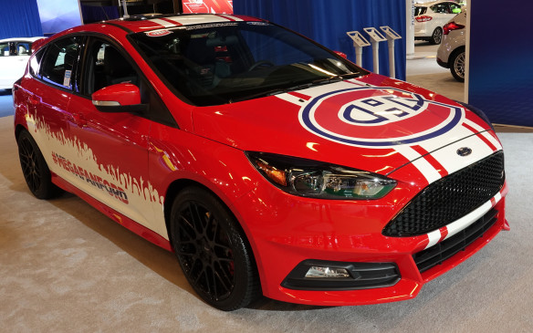 <p>Where else would you expect to see a Ford Focus in bright red with the famous logo of the Montreal Canadiens hockey team spread across its front hood? Go Habs Go!</p>