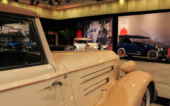 <p>As has become its custom, the Art and the Automobile exhibit constitutes a gallery-like setting with most of the cars displayed in front of backdrops depicting scenes from Canadian history of the same period as their construction.</p>