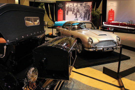 <p>The 1965 Aston Martin DB5 seen here beyond the trunk of a Duesenberg Model J is arguably the most famous car model ever for it's the same one driven by James Bond in the movie Goldfinger.</p>