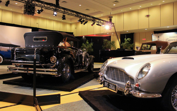 <p>While the Art and the Automobile feature focuses on the automobile's role in the context of Canadian history, not all the vehicles on display were built in Canada – witness the Duesenberg Model J and Aston Martin DB5 in this photo.</p>