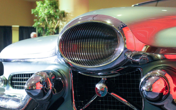 <p>Where are the headlights? They're hidden, side-by-side behind that jet-intake styled high central grille, which flips180 degrees to expose them when needed.</p>