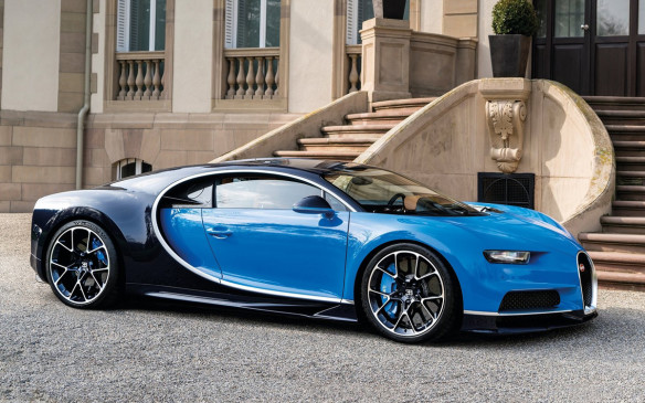 <p>The latest car from Bugatti, the new Chiron shows design cues throwing back to the century-plus history of the marque — among them, the blue exterior paint matching that of the old race cars, the elliptical cabin and window line of the Atlantic, and the arch radiator grille from Ettore Bugatti's first car, the Type 13.</p>