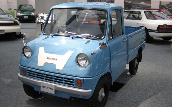 <p>Honda's first production auto, in 1963, was actually a pickup that beat the S500 roadster to market by about four months. Both the T360 and the S500 were derived from the prototype S360 roadster of 1962. The rear-drive T360 used the prototype roadster's 356 cc 4-cylinder engine, which provided 30 hp and could take the truck to a top speed of 100 km/h. A T500 version would come along later, using a 531 cc version of the same engine (as did the S500). For the truck it made 38 hp but in the roadster, it made 44. Cargo van, flatbed, flatbed with drop box-sides, and rear snow-track variants were also produced over the model's 4-year production run. (Credit: Wikipedia/韋駄天狗)</p>