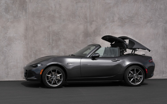 <p>Mazda engineers spent much time and effort trying to come up with a retractable roof design that would deliver the open-air experience owners wanted – 80% said they expected to do most of their driving with the roof retracted – yet still be configured in a way that didn't intrude on the MX-5's existing cargo and storage space. The resulting design allows the roof to fold into the same storage area behind the front seats as the soft top.</p>