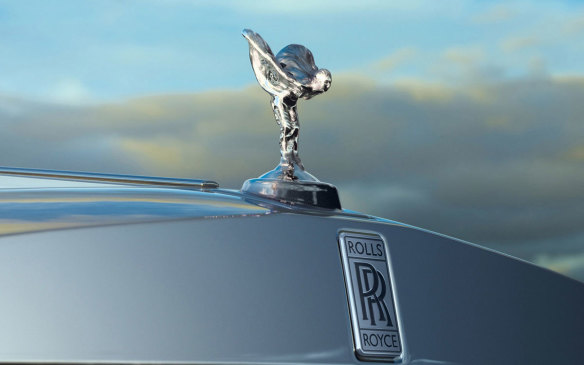 "<p>Rolls-Royce's famous ornament, and perhaps history's most famous of the genre, was created by English sculptor Charles Robinson Sykes due to customer feedback that the prestigious marque needed an equally prestigious signature cue, and also because of Rolls-Royce's displeasure with the ""aftermarket"" ornaments adorning their radiators. Sykes adapted it from his The Whisper figurine (of which only a handful were ever made) that adorned the 1910 Ghost. It's been on just about every Rolls-Royce since 1920.</p>"