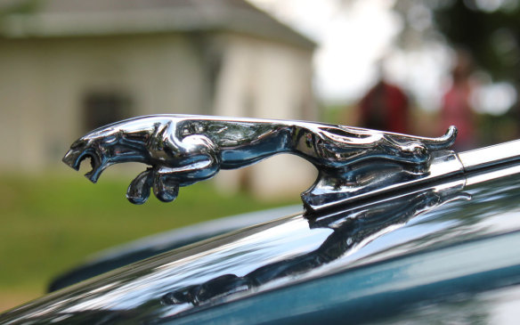 <p>Another well known hood sculpture, Jaguar's mascot was created by automotive illustrator and painter Frederick Gordon Crosby, and first appeared on a Jaguar car in 1938. The original design was of a crouching cat, beginning its pounce, but it was changed to one in mid-leap in the 1950s. The Leaper continued to appear on Jaguar hoods through 2005 (in later years as an optional accessory), and continues to this day in cameo profile on the cars' trunks. (Credit:Wikipedia/Hellooo)</p>