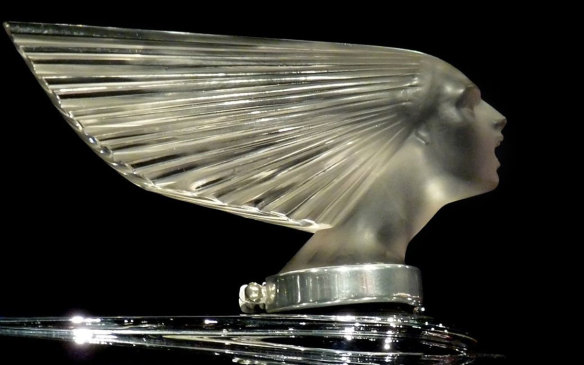 <p>Very early on, sculptors and other artists turned their attention to radiator cap ornaments, creating ways for car owners to personalize their new possessions. One such artist, glass-worker René Lalique, create one of the most intricate mascots to ever adorn the hood of a car — Victoire, or Spirit of the Wind, was crafted in 1928 and has topped radiators from the well-respected such as Rolls Royce, to the little-known, such as Belgium's Minerva. (Credit: Wikipedia/Ingrid Taylar)</p>