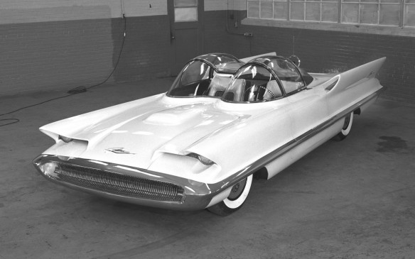 <p>The Futura prototype was a 1955 fully-functional car built by Ghia off a Continental Mark II chassis, and public approval on the auto show circuit lead to a line of toys and model kits. Futura showed off Ford's vision of future cars, with a 2-seat split cockpit housed under clear domes. Although the cabin didn't make it to production, light and fin styling cues were adapted for production Lincolns, as well as grille design for Mercury and Ford cars. And, it paved the road for future paint jobs with one of the first pearlescent paint applications.</p>