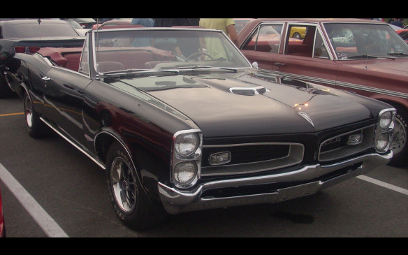 <p>The 1966 GTO was the first model in the series, which was an option package of Tempest in previous years, selling in 2-door coupe (with and without B-pillars) and convertible. It featured the first application of plastic grilles and newly-contoured bucket seats for improved occupant comfort. Power came from the 389 engines that put out 335 or 360 hp, which is the main reason the GTO is regarded as the first muscle-car. (Credit: Wikipedia/Bull-Doser)</p>