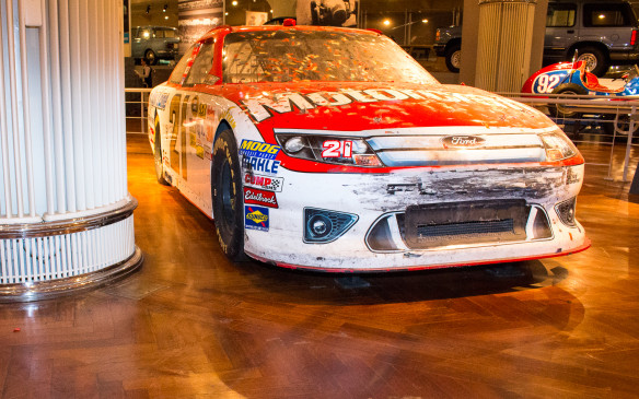 <p>This #21 Wood Brothers Ford Fusion, with Trevor Bayne at the wheel, won the Daytona 500 in 2011. It's preserved and displayed just as it finished the race, with confetti still glued to it from the victory bath of now-dried Gatorade and Coca-Cola.</p>