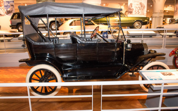<p>The height of Ford's success came with the Model T, introduced in 1908. This 1914 model was built in the first year of Ford's adoption of the moving assembly line and like all Model Ts of that era it is painted black, just one of the many cost-saving measures introduced with that process.</p>