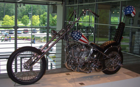 "<p>Wyatt's bike in Easy Rider is arguably the most instantly recognizable ""chopper"" ever. The hardtail Captain America, so nicknamed for its Stars-and-Stripes fuel tank, was designed and created for the film by bike builders Cliff Vaughs and Ben Hardy, from a 1952 police Hydra-Glide cruiser purchased at auction by the film's star and writer Peter Fonda. The only piece retained was the Harley-Davidson Panhead engine. (Credit: Wikimedia Commons/Silosarg)</p>"