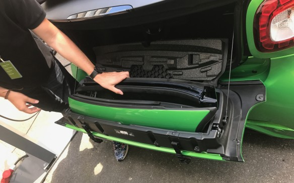 <p>The roof support bars stow easily in the compact trunk. This doesn't leave room for much else, but there's space for a couple of small bags back there.</p>