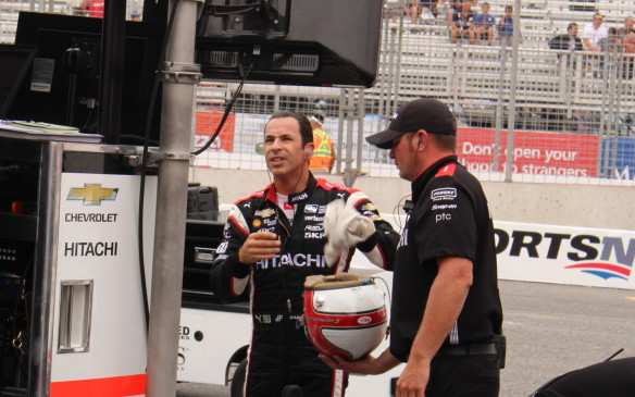 <p>Castroneves checked the time charts to see where others were as soon as he got of his car.</p>