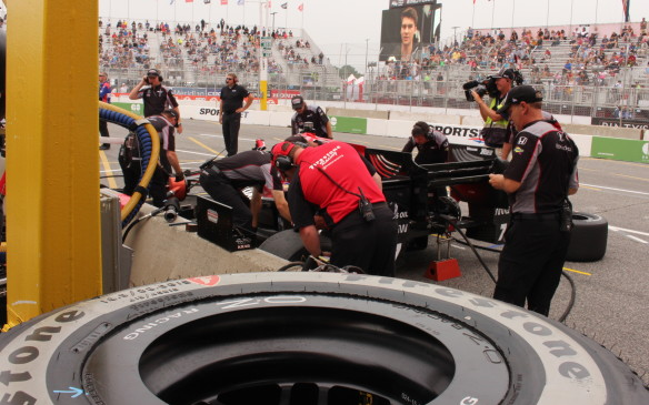 <p>Even during practice, pit stops are well choreographed with each crew member assigned specific tasks.</p>