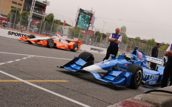 <p>Ultimate race winner, Joseph Newgarden, flashes past while Tony Kanaan waits for the track to 'rubber in' before joining first practice.</p>