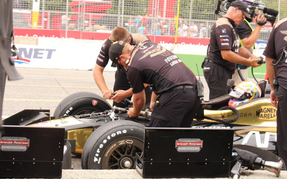 <p>Canadian racer, James Hinchcliffe, who finished third in the race, gets a quick front spring change during practice.</p>