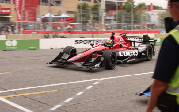 <p>Sebastian Saavedra, subbing for Mikhail Aleshin, dives for his pit during practice. The dotted line denotes the pit entrance boundary.</p>