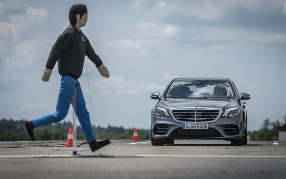 <p>Mercedes recognized this reluctance and set up a closed course, with stalled cars on the highway ahead and pretend pedestrians crossing in front of the speeding car so we could try out the features.</p>