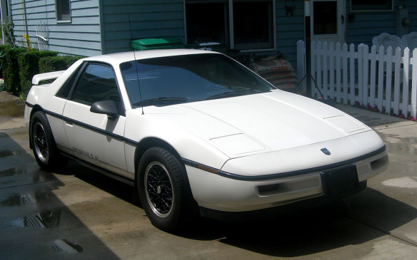 <p>General Motors took on the Europeans about a decade after the demise of the Corvair when it introduced the mid-engined 2-seat Fiero that even beat out the new C4 Corvette for the honour of pacing the 1984 Indianapolis 500. Its 2.5-litre 4-cylinder engine turned over great fuel economy (a priority at the time) but didn't churn out the expected high-revving performance of the exotic Europeans it reminded buyers of. Plus, GM's cost cutting measures meant it got suspension, brakes and tires from economical models, instead of the specific components such a promising model deserved. (Credit: Wikipedia/jonrev)</p>
