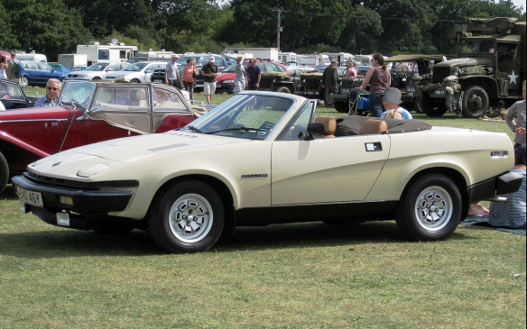 <p>The sports coupes at the time were heavy into aerodynamic efficiencies, with the most prominent feature being retractable headlights. The Triumph TR7 went one further with a pronounced wedge shape that seemed to take downforce to the max for the diminuitive coupe and convertible. However, the futuristic shape wasn't enough to offset a reputation of quality control problems mostly caused by management/workforce issues at the production facility. (Credit: Wikipedia/Charles01)</p>
