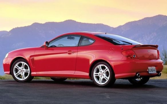 <p>Foreign words add a certain flair and sophistication, even if the words themselves designate nothing spectacular. Hyundai's sporty coupe took the name Tiburon (Spanish for shark), completing the image with a sleek profile, gill-like fender vents behind the front wheels, and an available caudal-fin shaped high spoiler forthe rear deck.</p>