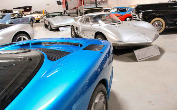 <p>Mixed in with all the production cars is an exceptional assortment of GM concept cars spanning more than six decades. The silver concept car here is the 1962 Corvair Monza GT, seen over the rear haunch of the 1990 CERV III Experimental car.</p>