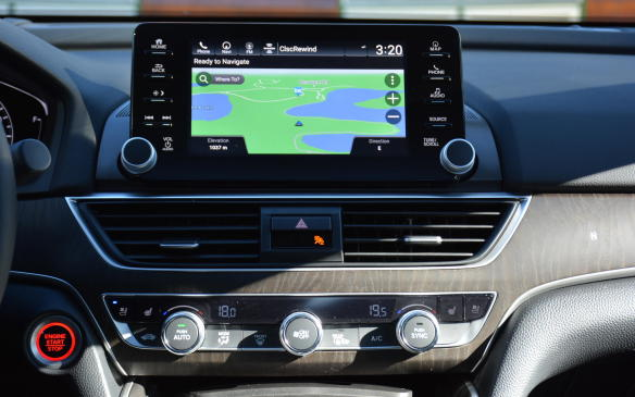 <p>On the inside, Honda has dropped its dual-screen infotainment unit in favour of a standard eight-inch floating screen that sits on top of the instrument panel. This configuration may seem familiar, as its also used by the Mazda6, but that's no bad thing, and the Accord goes the extra mile by surrounding the touchscreen with real buttons and knobs!</p>