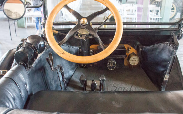 <p>There was little in the cockpit to distract the driver. Engine speed was controlled by a throttle stalk behind the steering wheel, on the right. The stalk on the left controlled spark advance. The Model T didn't even incorporate an electric starter until 1919and amenities such as a heating and defrosting were still far in the future.</p>