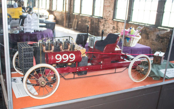 """<p>Prominentlydisplayed within the museum is this model of 'Old 999,' one of two such cars built by Henry Ford in 1902. Ford engaged former bicycle racer Barney Oldfield to drive Old 999 and he defeated Alexander Winton, then the most prominent automaker in the U.S.A., in a match race in Detroit. That victory helped Henry find financial backing to form the Ford Motor Company. A full-size <a href=""""https://autofile.ca/en-ca/car-photos/the-race-cars-of-the-henry-ford-museum"""">reconstruction of the car</a> is on display at <a href=""""https://autofile.ca/en-ca/car-photos/the-historic-cars-of-the-henry-ford-museum"""">The Henry Ford museum</a>.</p>"""