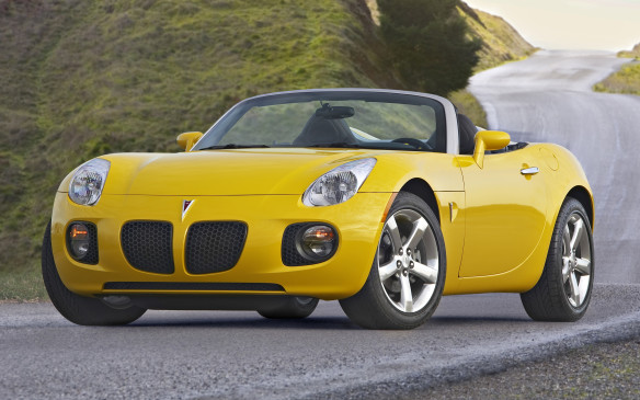 <p>While representing less than 1% of the automotive market, two-seat roadsters can cast a halo over an automaker's wares that helps to boost sales. That's the theory, anyway. Debuting for 2006, the rear-drive platform of the Pontiac Solstice ragtop (shown here) consisted of hydroformed frame rails and a central tunnel that housed the transmission and driveshaft. There was plenty of sports-car goodness, including rack-and-pinion steering, forged aluminum control arms with Bilstein monotube shocks and 18-inch alloy wheels standard. The two-place cabin was reasonably spacious, but owners noted the plasticky instrument panel felt a little too dollar-store cheap.</p>