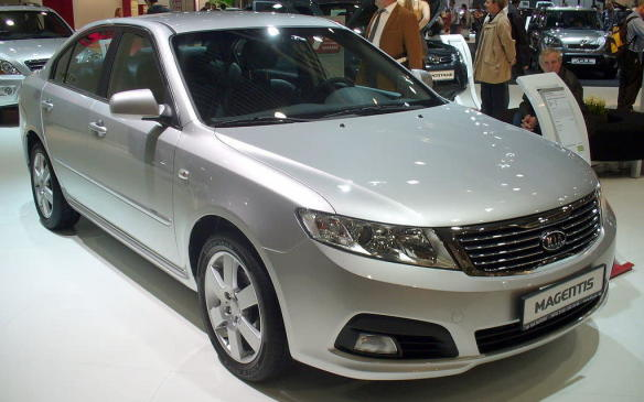 <p>Redesigned for 2007, the hermit-like Kia Magentis sedan borrowed the platform of its corporate mate, the Hyundai Sonata, but this time product planners cleaved some space between the two. The Magentis benefited from a wider track, while MacPherson struts held up the front end and a trailing-arm independent suspension supported the rear. The cabin had enough interior volume to technically classify it as a large car. The instrument panel had a pleasing shape with tight seams and the controls worked with damped movements. The seating was elevated off the floor and shaped to accommodate people of all sizes.</p>