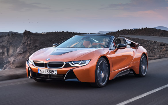 "<p>BMW has teased us with a roadster version of its <a href=""https://autofile.ca/en-ca/car-photos/up-close-and-personal-with-bmws-i8-hybrid-sports-car"">i8 plug-in hybrid sports car</a> since the sexy coupe's introduction in 2014. Now the teasing is over, with a production version slated to go on sale in Spring, 2018. Both the Roadster and the updated i8 Coupe will have more power – 369 hp ( 12 hp) - and a refined high-voltage battery with increased capacity and range. With hybrid-specific all-wheel drive, an internal combustion engine driving the rear wheels and an electric motor driving the front wheels, acceleration from 0 to 100 km/h is said to take just 4.4/4.6 seconds (preliminary) for the Coupé and Roadster respectively.</p>"