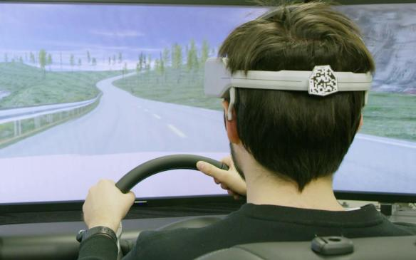 """<p>Nissan used a driving simulator to display its <a href=""""https://autofile.ca/en-ca/auto-news/nissan-gets-in-drivers-brain-to-improve-efficiency"""" rel=""""noopener noreferrer"""" target=""""_blank"""">Brain-to-Vehicle (B2V) technology</a> that uses brain-decoding to predict driver actions, such as turning the steering wheel or stepping on the brake, which would enable driving aids to be activated sooner, thus improving reaction times.</p>"""