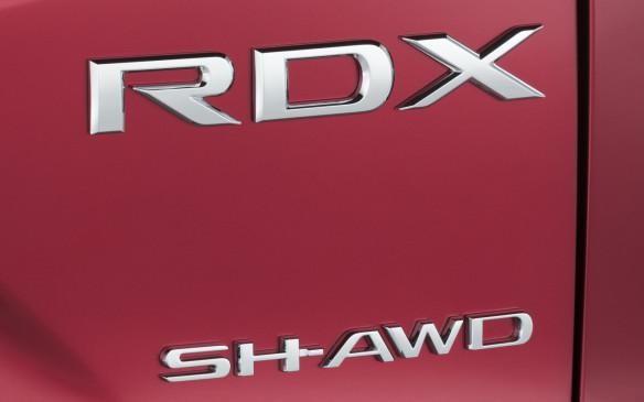 <p>Acura RDX badge</p>