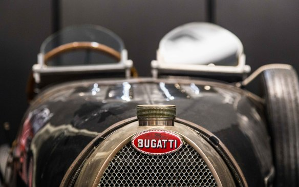 <p>Ettore Bugatti enlisted his father, Carlo, an influential designer, jeweler and artist in Milan, to design the emblem for what would become the iconic brand. The oval-shaped logo he created has symbolized the brand almost unchanged ever since. Its red, white and black colours are said to represent passion, and power, elegance and nobility, and excellence and courage, respectively. The reversed E and the B above the name are Ettore Bugatti's initials.</p>