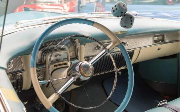 <p>The hanging dice add a touch of period whimsy to what was then the height of luxury in this 1953 Eldorado's interior.</p>