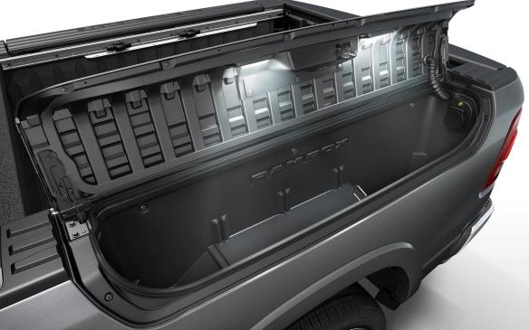 <p>The Ram 1500 has 151 litres of interior storage volume, which is nearly 100 percent more than its closest the competitor. In the spacious Crew Cab cabin, for example, the rear bench seat flips up for 20 litres of contained storage space in under-seat compartments, while fold out feature doubles that storage space to 40 litres. On either side of the new flat load floor, there are two new, enlarged Ram Bins for covered in-floor storage. The bins are now 140 mm longer than the previous model, making them capable of storing larger items, such as a four-inch drop hitch. On top of each Ram Bin are two tie-downs to keep cargo secure. In the pickup bed, Ram's unique RamBox lockable bed storage compartments have been upgraded. They now feature a 115-volt outlet and overhead lighting relocated to the box lids to improve illumination.</p>