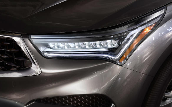 "<p>Elegance is readily apparent in the Acura RDX, with the ""diamond"" grille flanked by ""jewelled"" LED headlights totalling seven on each side (up from five). At the other end, the LED taillights are presented in a ""dragontail"" signature.</p>"
